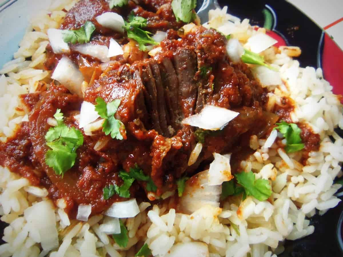 Braised Skirt Steak In a Spicy red Wine Sauce over Lemon Cilantro Rice
