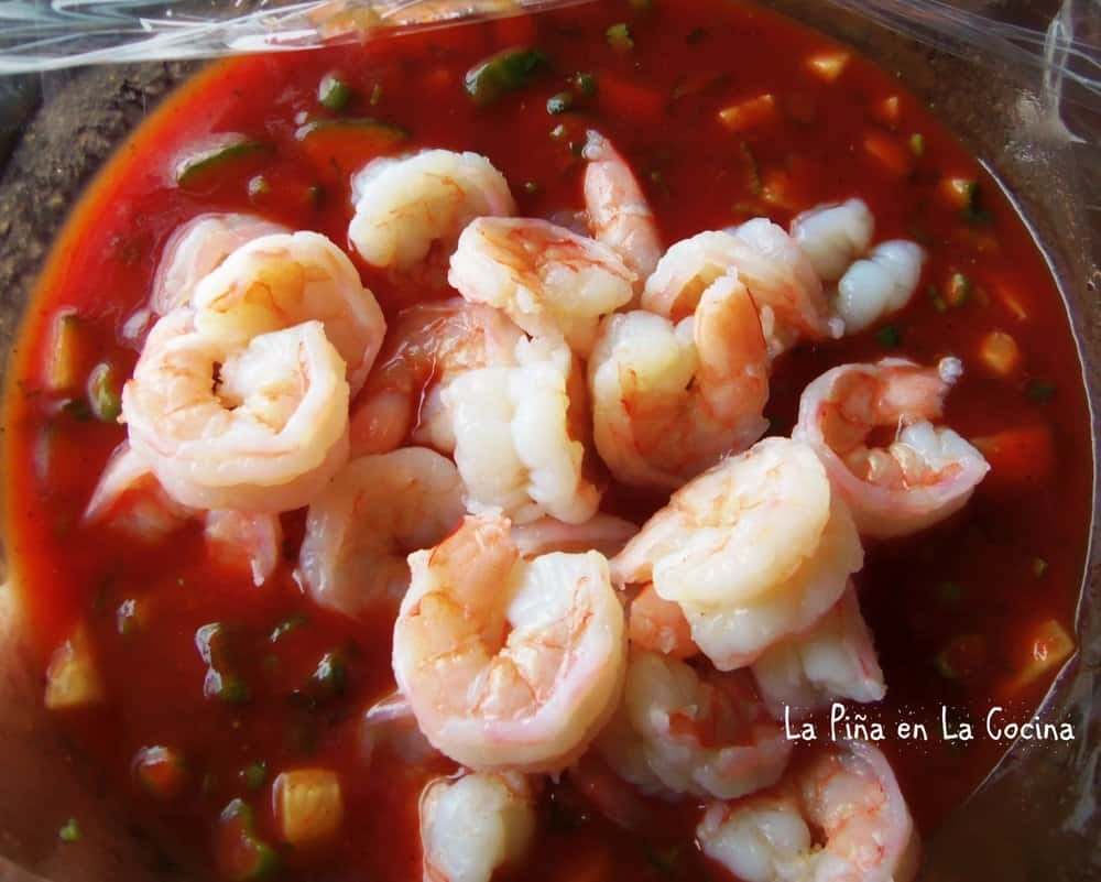 Top view of shrimp going into bowl