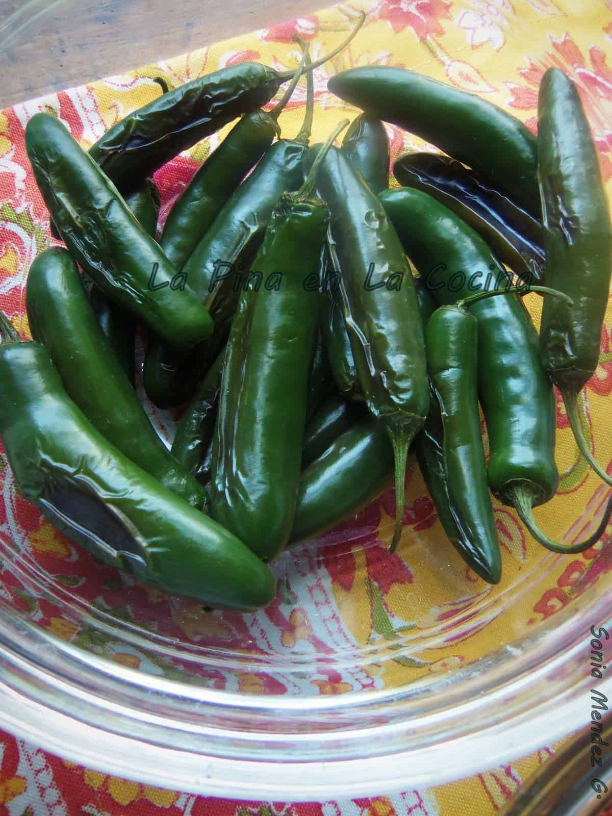 Remove the stems from the peppers before roasting, poaching or grilling. When working with large quantities of peppers, the less you handle them the better.