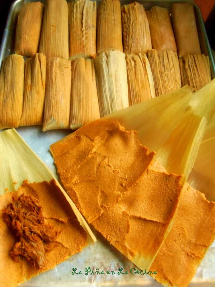 Chile Colorado Pork Tamales, spreading masa and filling with meat