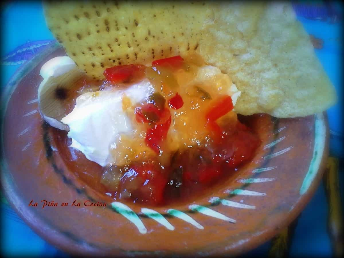 Spicy Pepper Jelly ove Cream Cheese Served with Chips