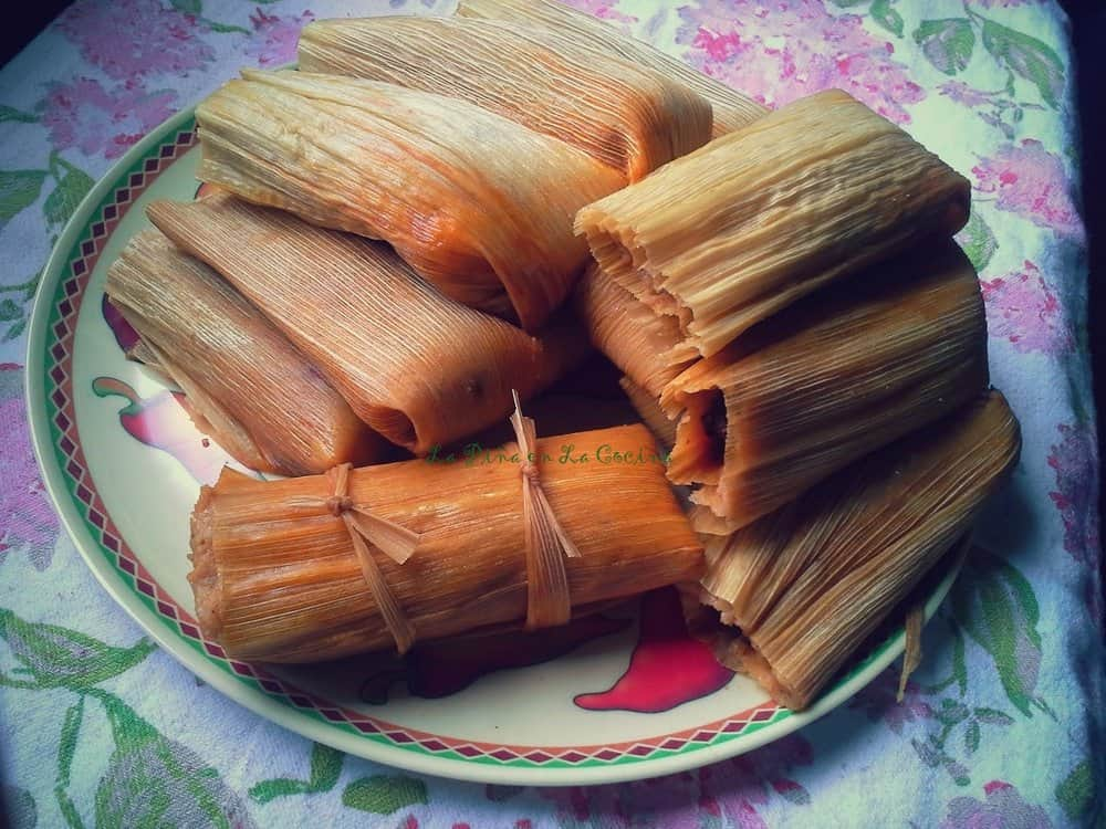 Chile Colorado Pork Tamales on a plate after steaming