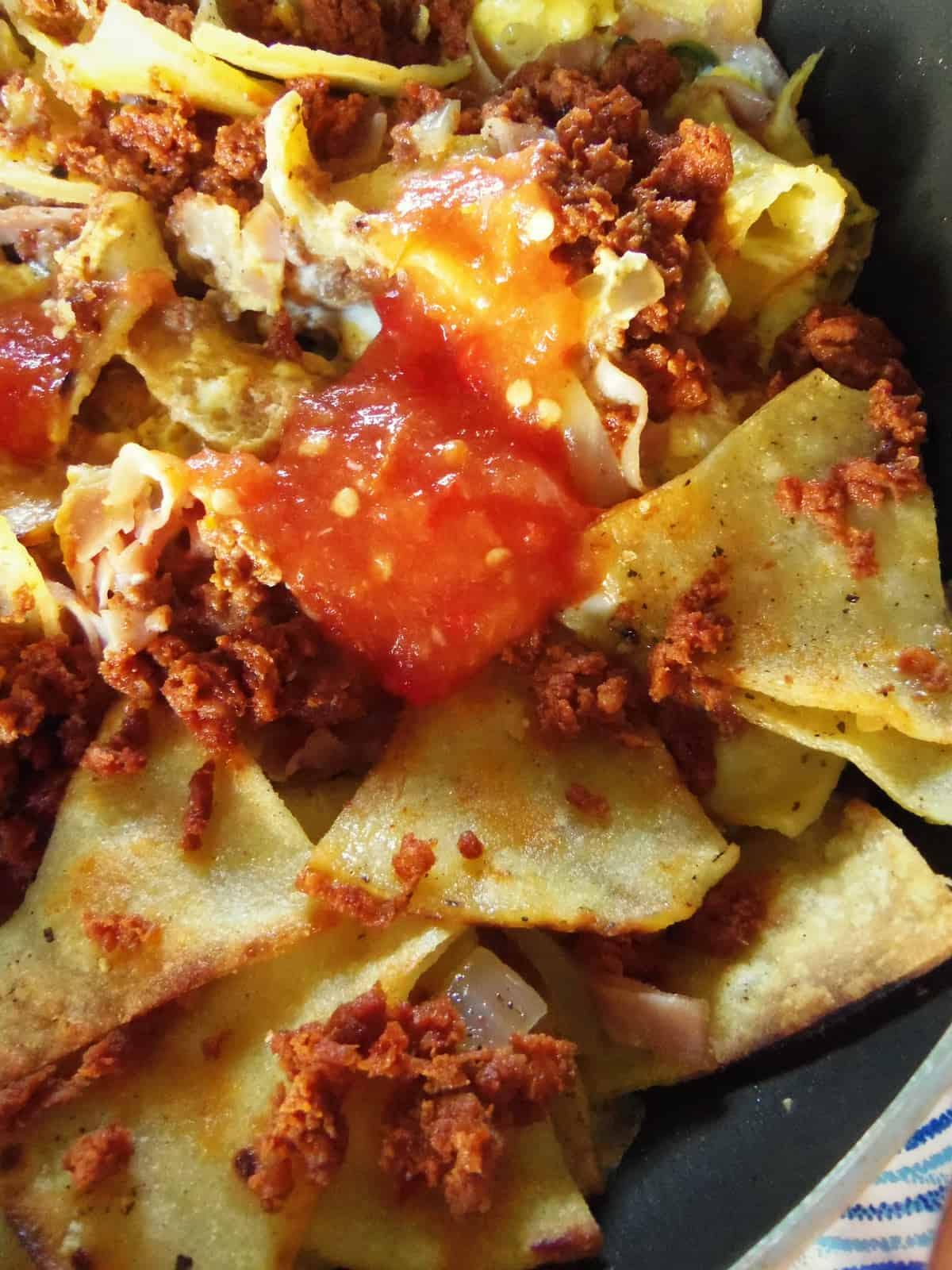 Migas, torn or cut pieces of tortilla mixed with eggs and chorizo