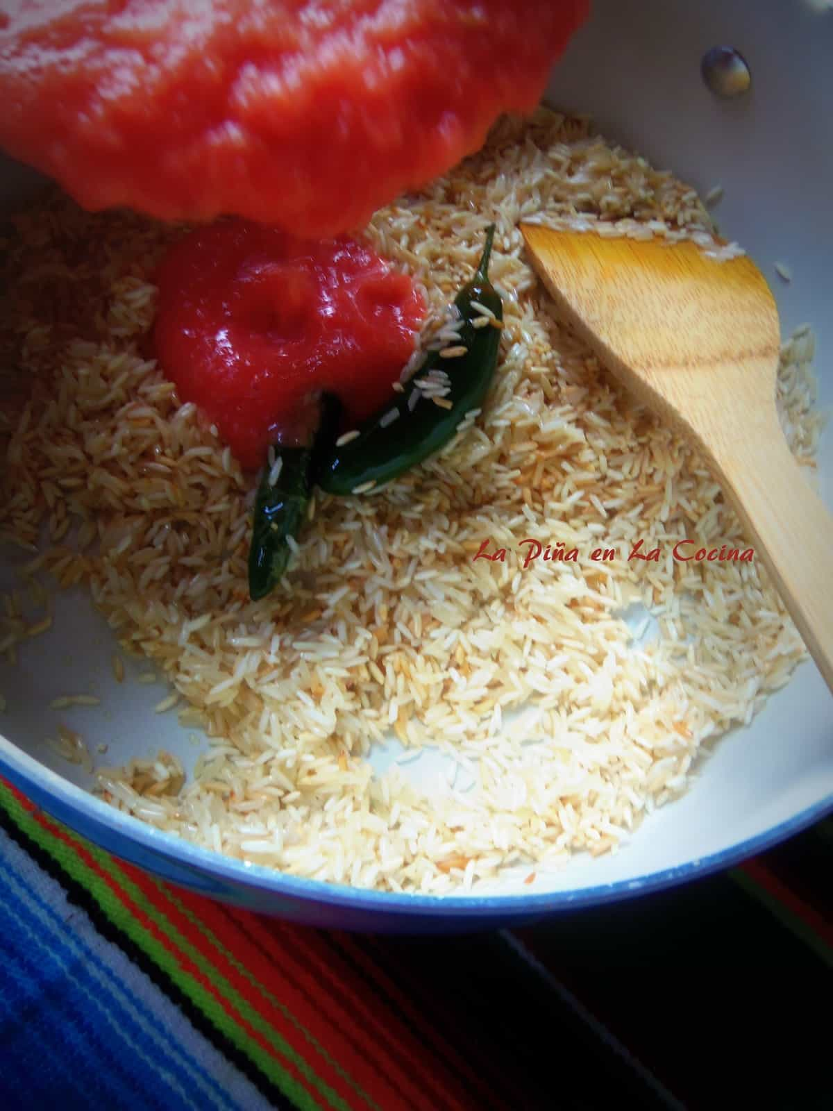 When using freshly blended tomato sauce, the rice will  come out a light orange color.