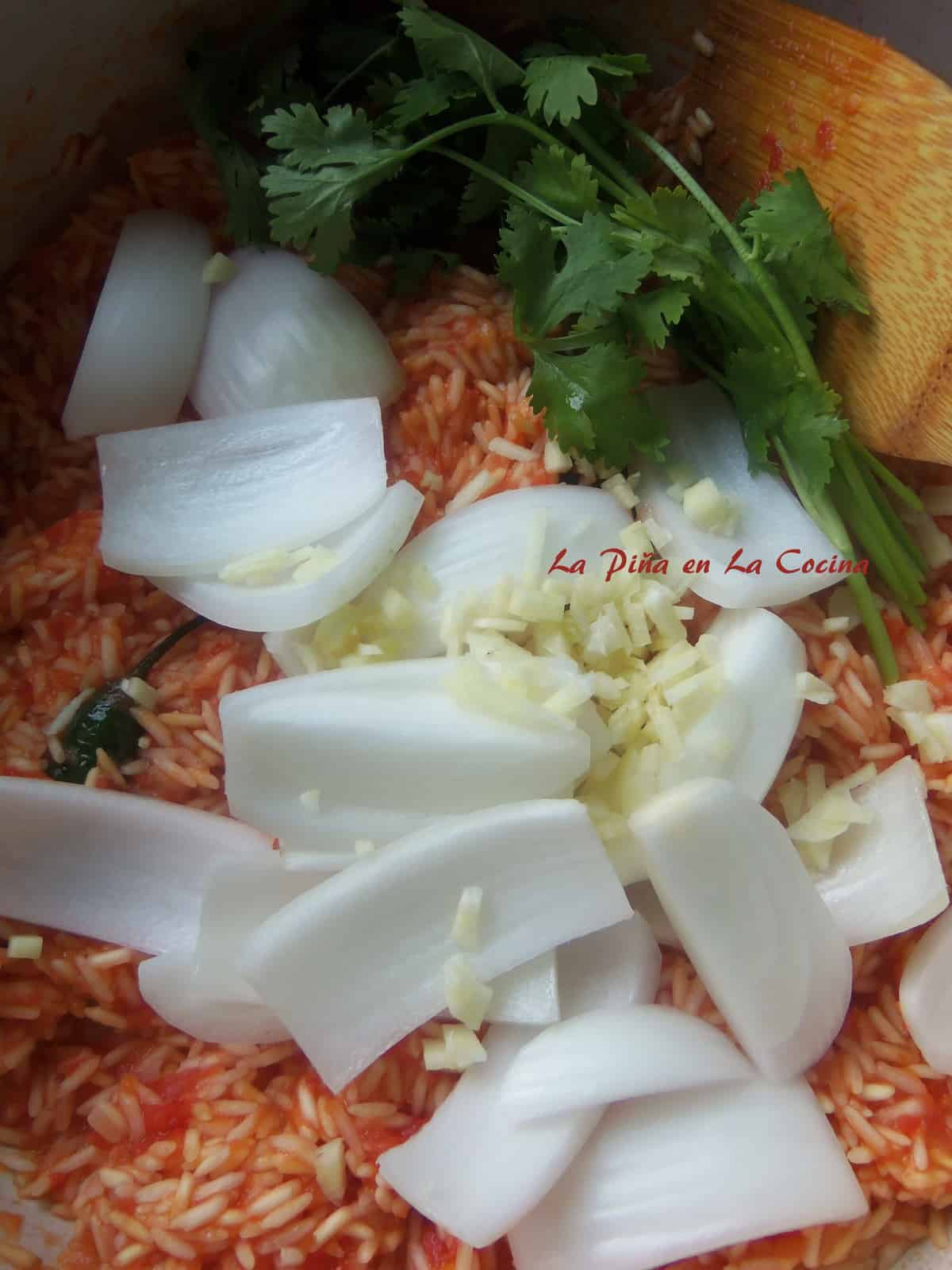 If you choose to leave the onion pieces larger, just add them in with the cilantro and garlic before adding the liquid to the rice.