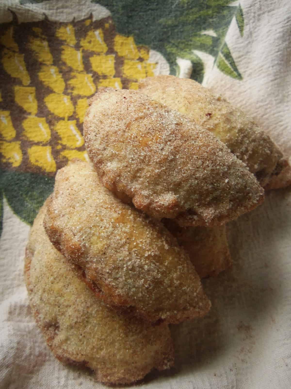 Empanadas de Piña Dredged in Cinnamon and Sugar
