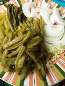 Blanched Nopales, Roasted Poblanos, Chilacas, Onions and Garlic
