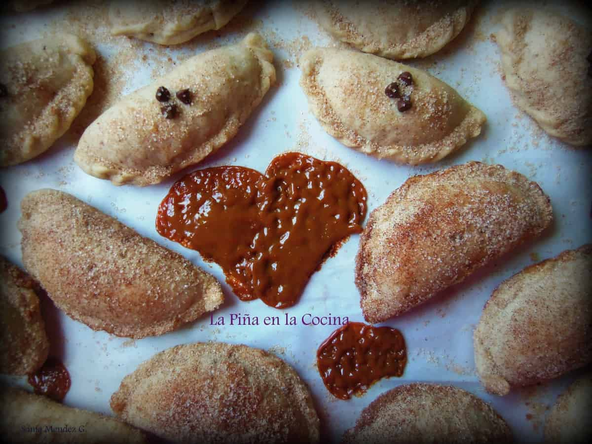 Mini empanadas, some filled with dulce de leche and some filled with semi sweet chocolate