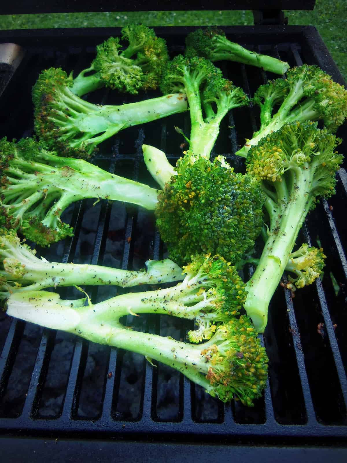 Grilling broccoli for the first time. It only takes a few minutes. I would steam them in the microwave for a few minutes before grilling next time.
