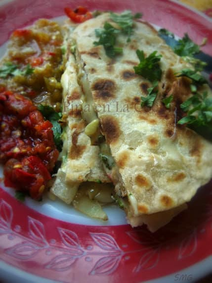 Grilled Veggie Quesadillas served with both red and green salsa's.