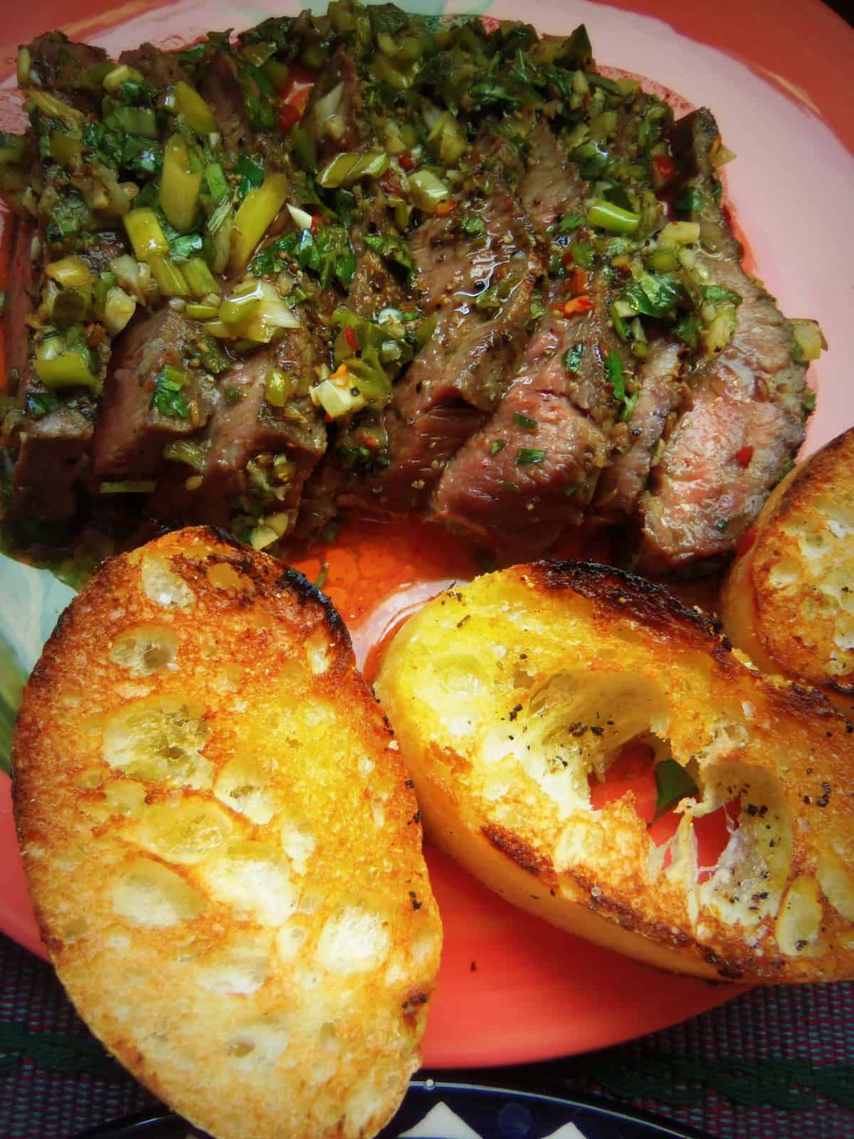 You must have some warm, toasted crostini for this steak to soak up all that wonderful chimichurri
