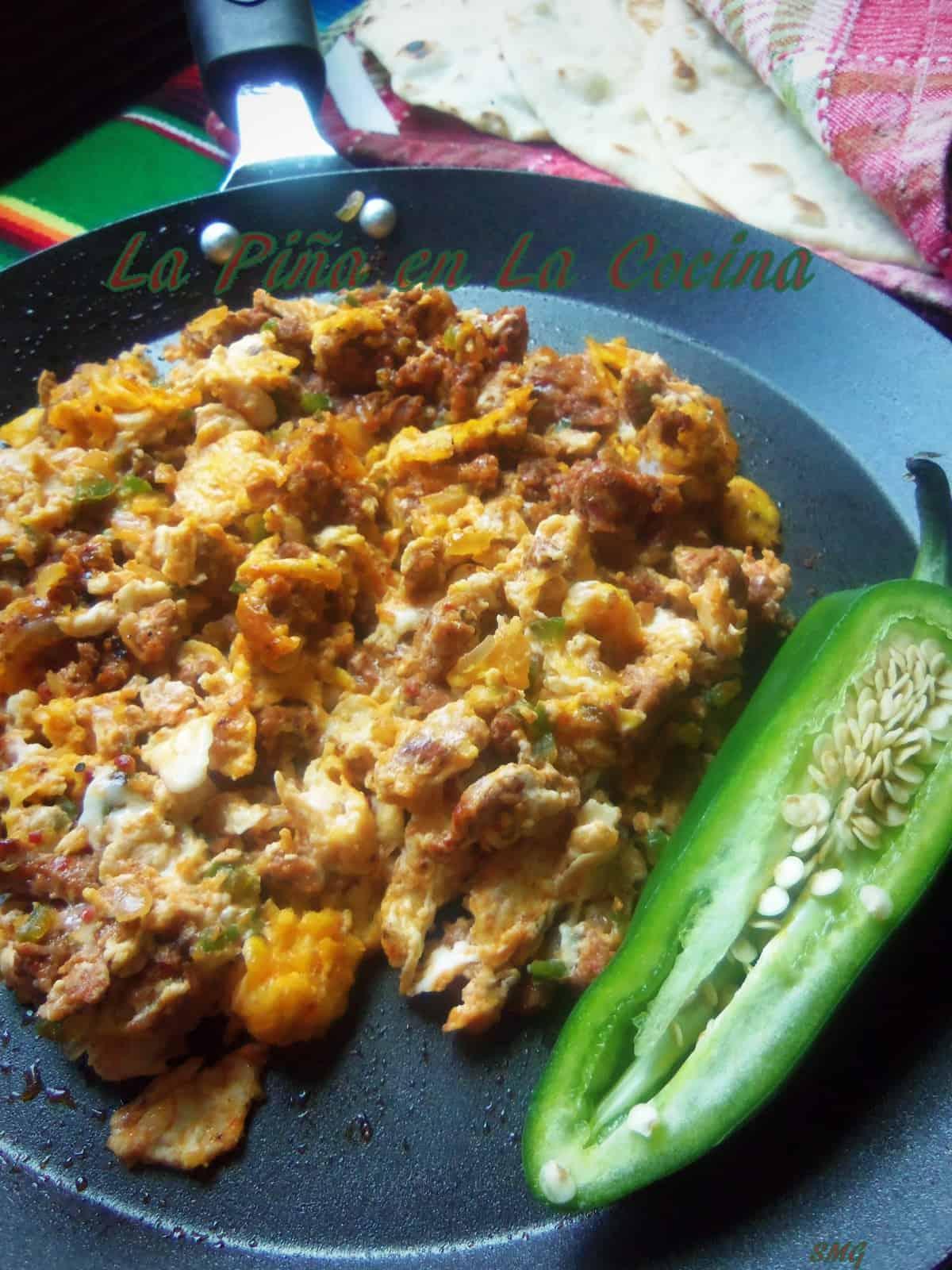 Chorizo con Huevo prepared with homemade pork chorizo