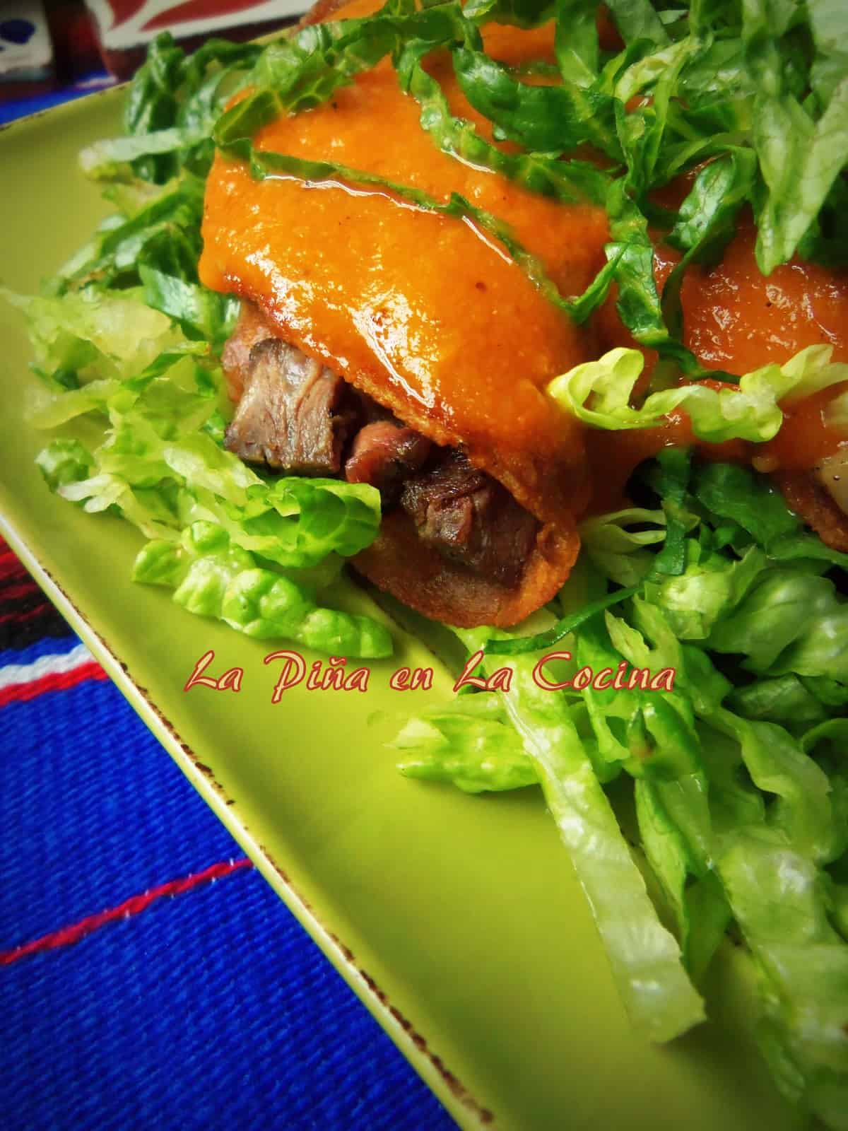 This enchilada sauce was prepared in the same way as recipe above, with the added 1 cup of roasted pureed tomatoes. Filled with thinly sliced steak.