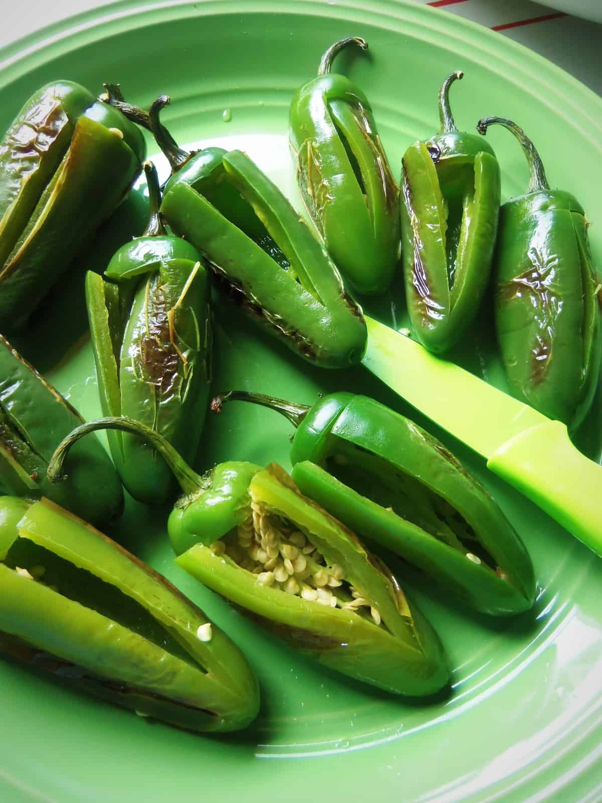 Partially roasted jalapeños work well for poppers with a batter or breading. The flour adheres much better than on a raw pepper.
