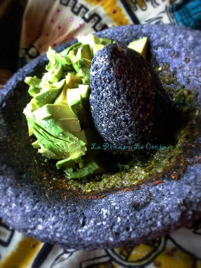 Adding a perfectly ripe avocado, a gentle smash, perfect guacamole.