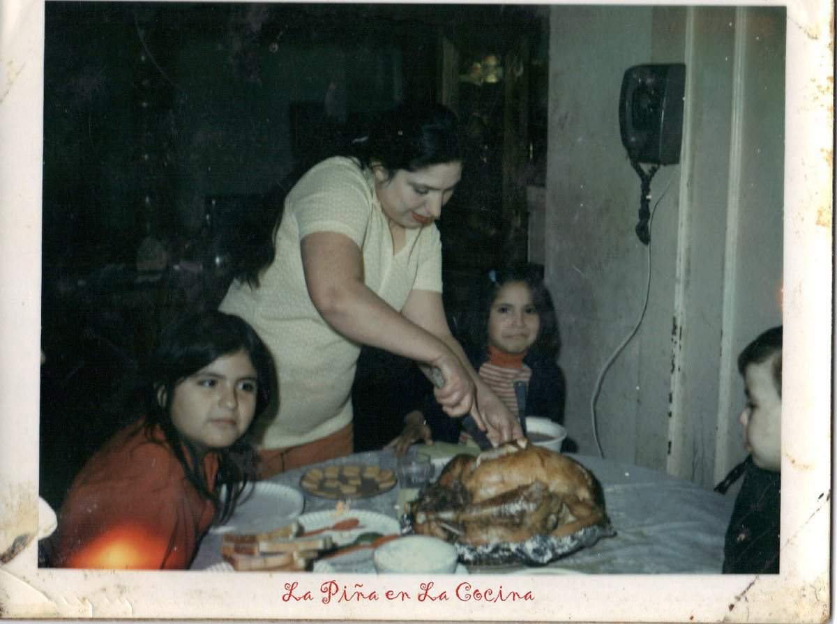 There is my beautiful Mom slicing the turkey. That's me next to her on the right. Those were special times.