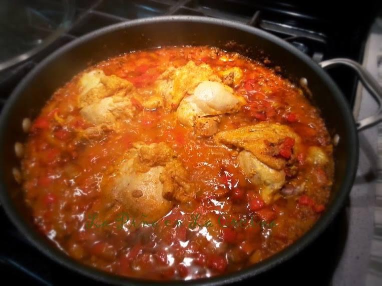 Braising the chicken in the sauce for Tinga de Pollo