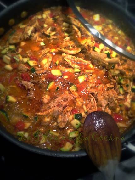 Tinga de Pollo reducing in the sauce with all the aromatics and calabacitas