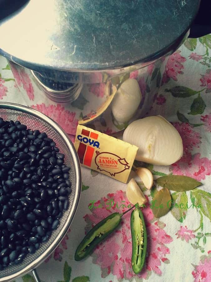 I used a 5 quart pressure cooker for 1 pound of black beans