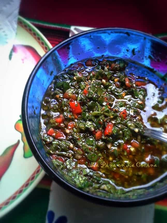There are many variations of a chimichurri sauce. I like to chop mine fine by hand and add sweet and hot chile peppers to my recipe.