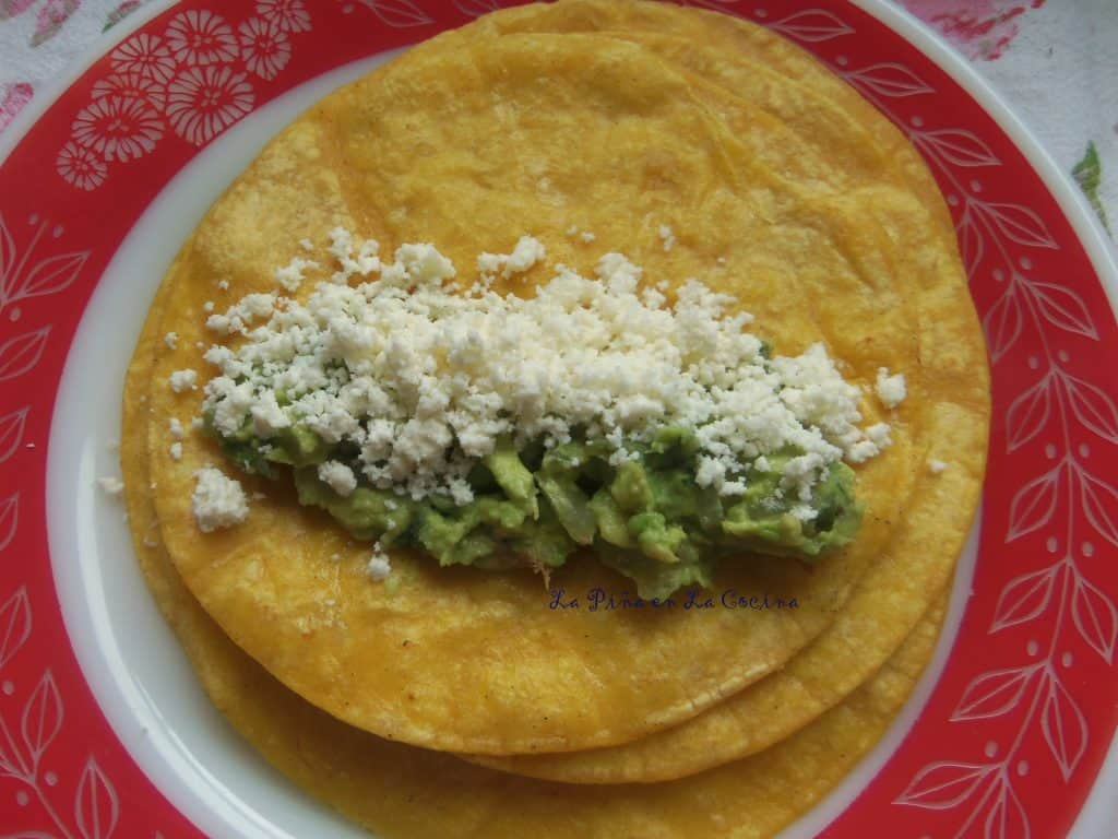 Roasted Poblano Sauce Enchiladas Filled with Guacamole and Queso Fresco