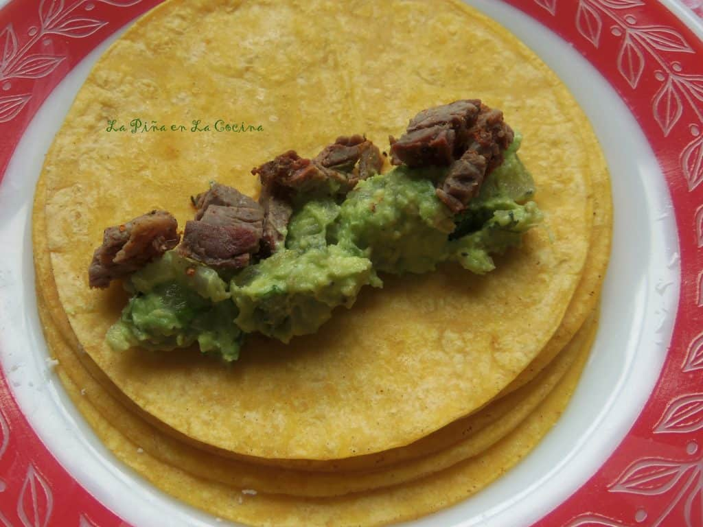I enjoy adding  a fresh guacamole to my enchilada filling for a creamy texture.