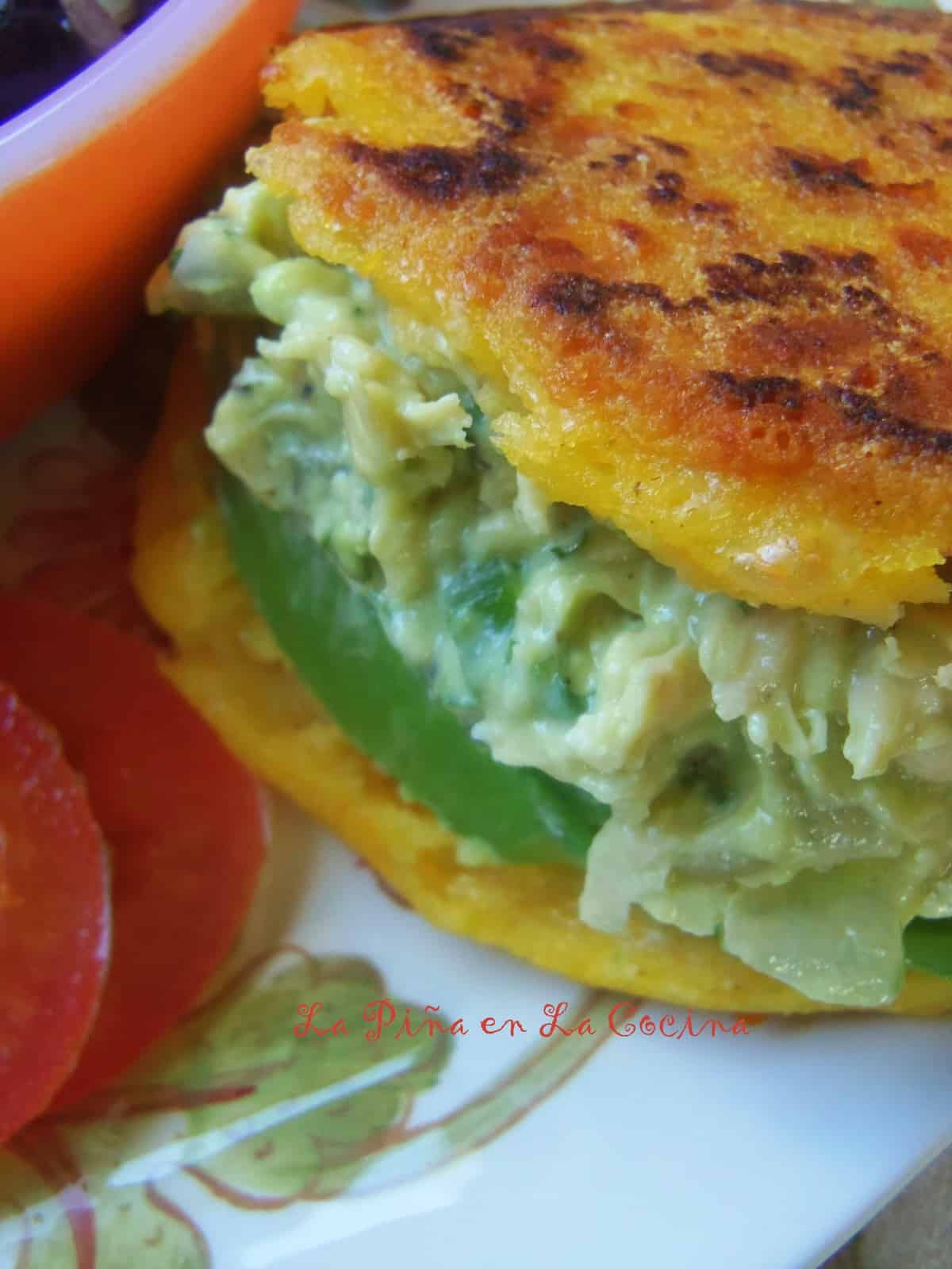 An arepa corn cake filled with reina pepiada, a fresh avocado chicken salad.