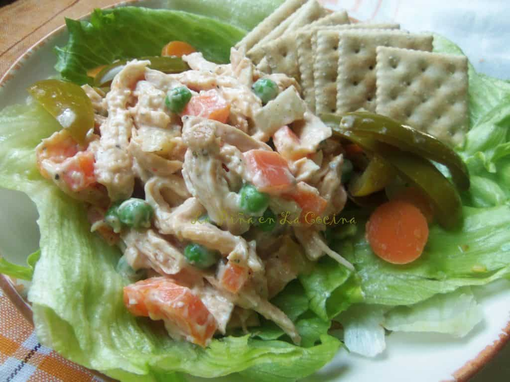 Ensalada de Pollo, chicken salad on lettuce leaves with crackers close up