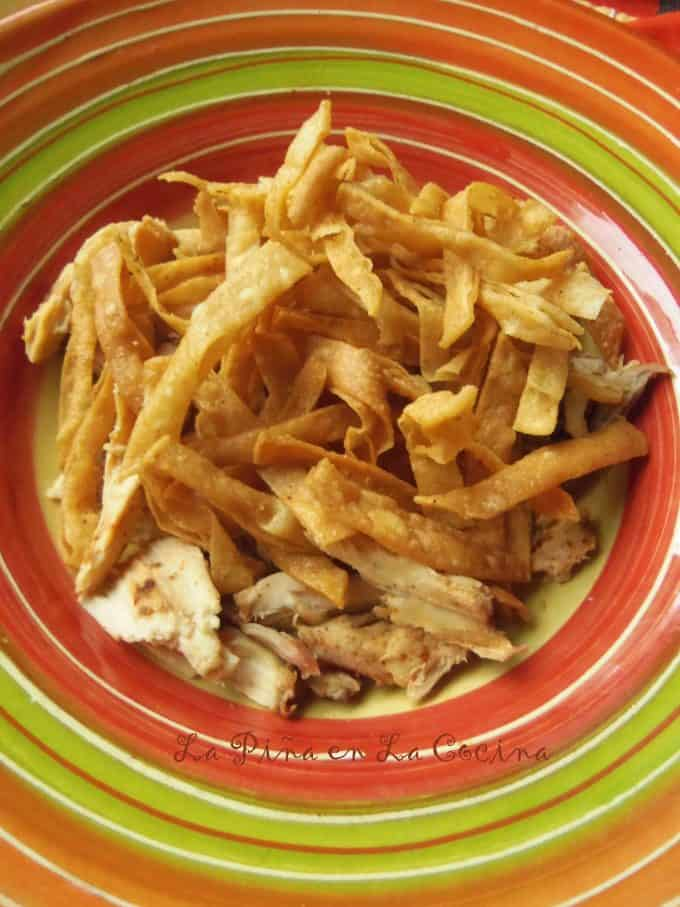 Building chicken tortilla soup. layer shredded chicken, then fried tortilla strips