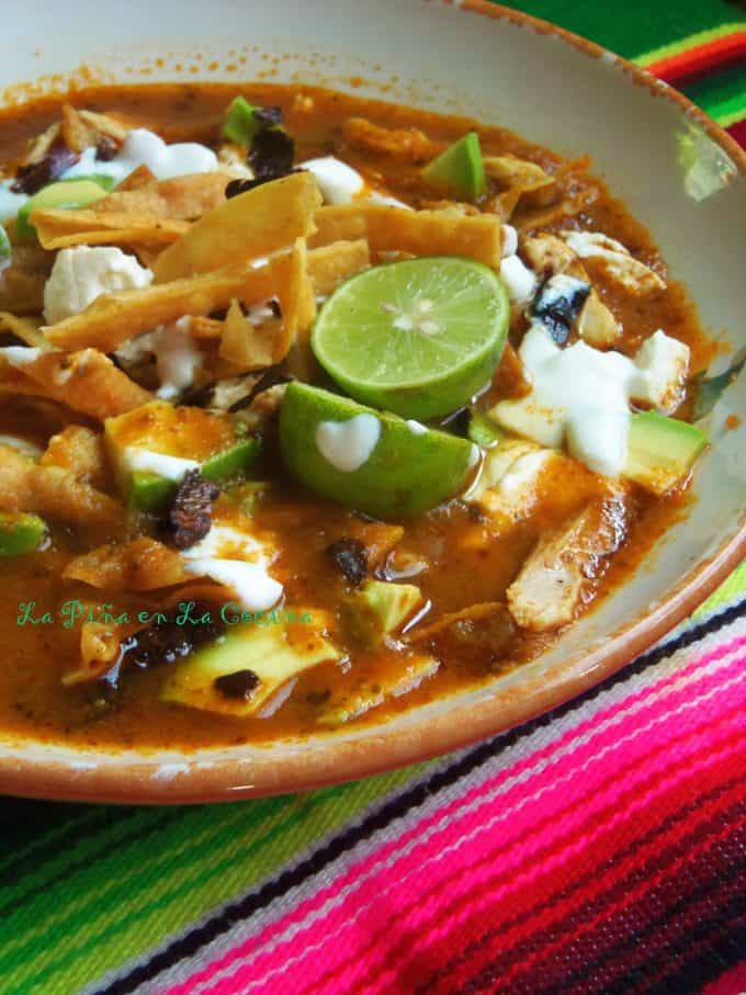 Tortilla Soup with Garnishes in shallow bowl