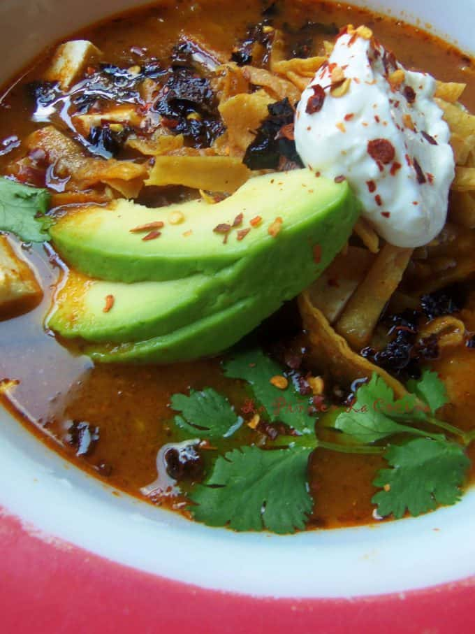 Tortilla soup ready with all the garnish