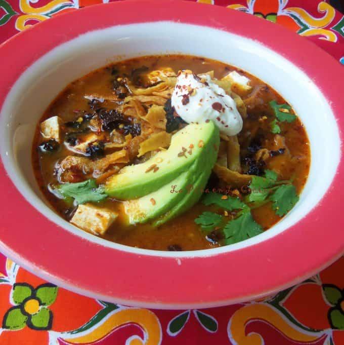 Sopa Azteca-Sopa de Tortilla(Tortilla Soup) in a large bowl with garnishes