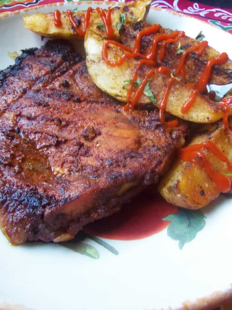 pork chop on plate with potatoes