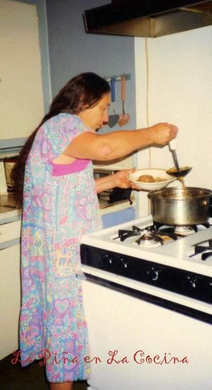 Mom serving up the menudo- La Piña en La Cocina