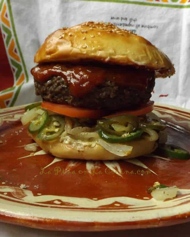 Big Burger on a Homemade Cemita Roll. Garnished Salsa de Chile Morita y Piquin