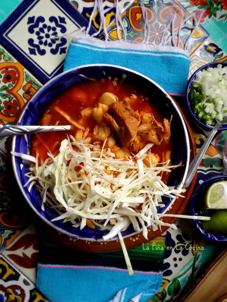 Red chile pork pozole in bowl top view