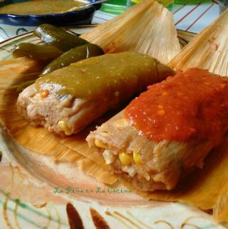 Fresh corn tamales with red and green salsa