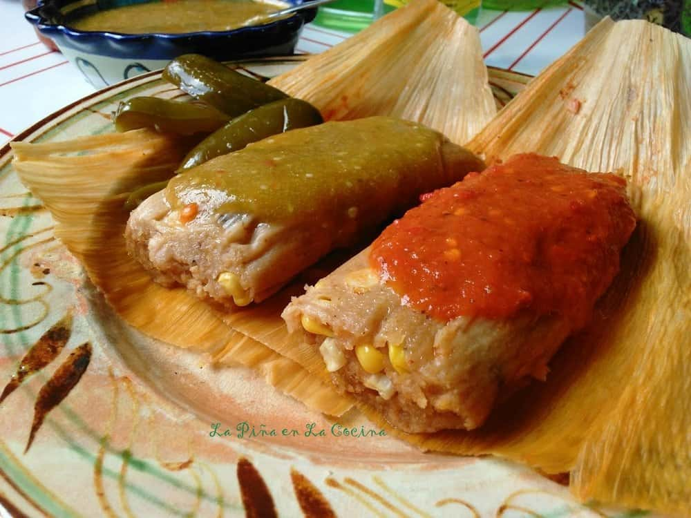 Fresh Corn Tamales with Cheese and Jalapeño garnished with red and green salsa