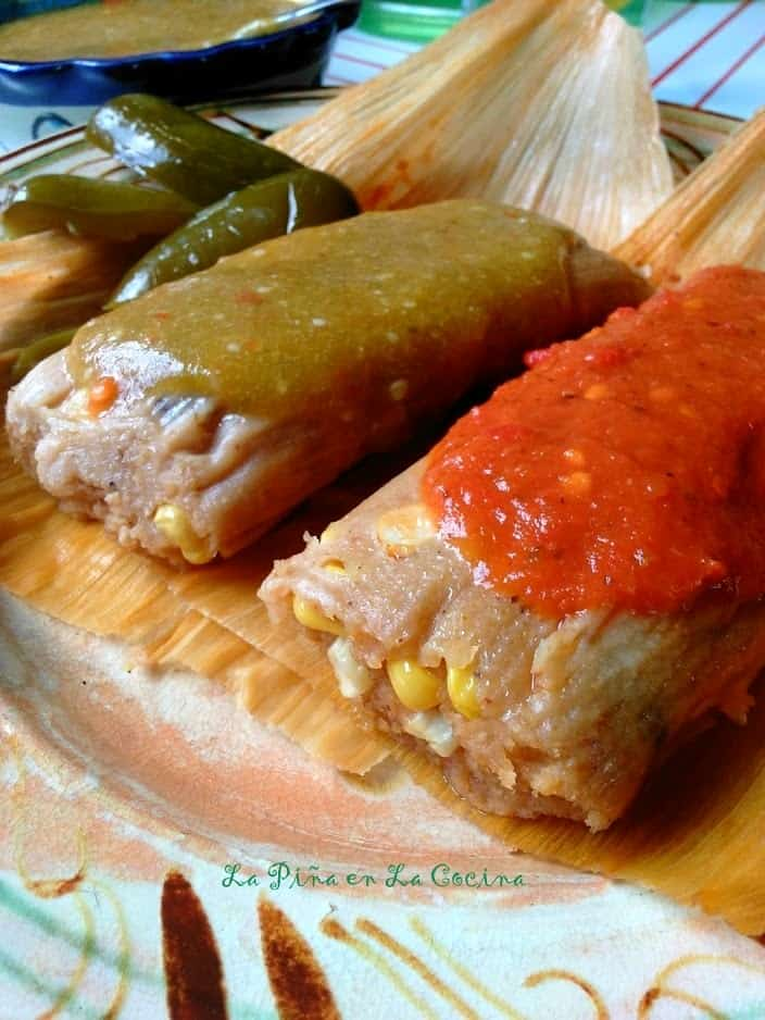 Fresh Corn Tamal es with Cheese and Jalapeño garnish with red and green salsa