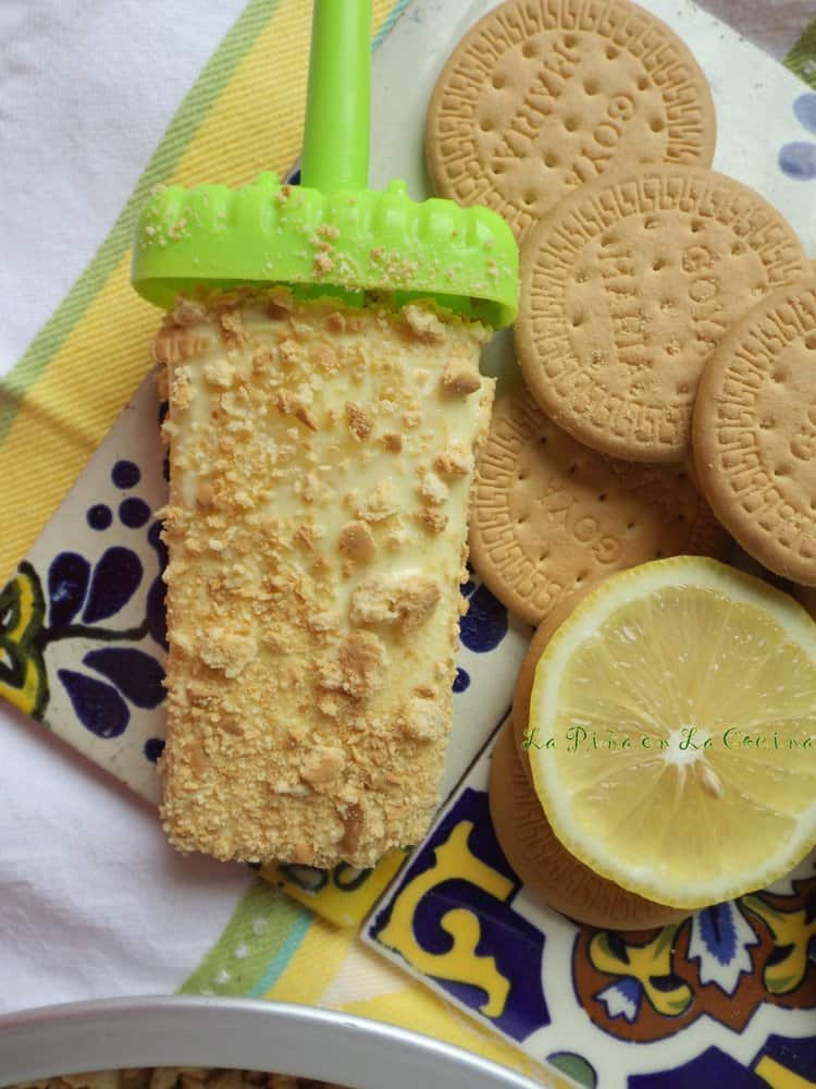 Pay de Limon Paletas-Lemon Pie Popsicles on tiles with Maria Cookies and sliced lemon