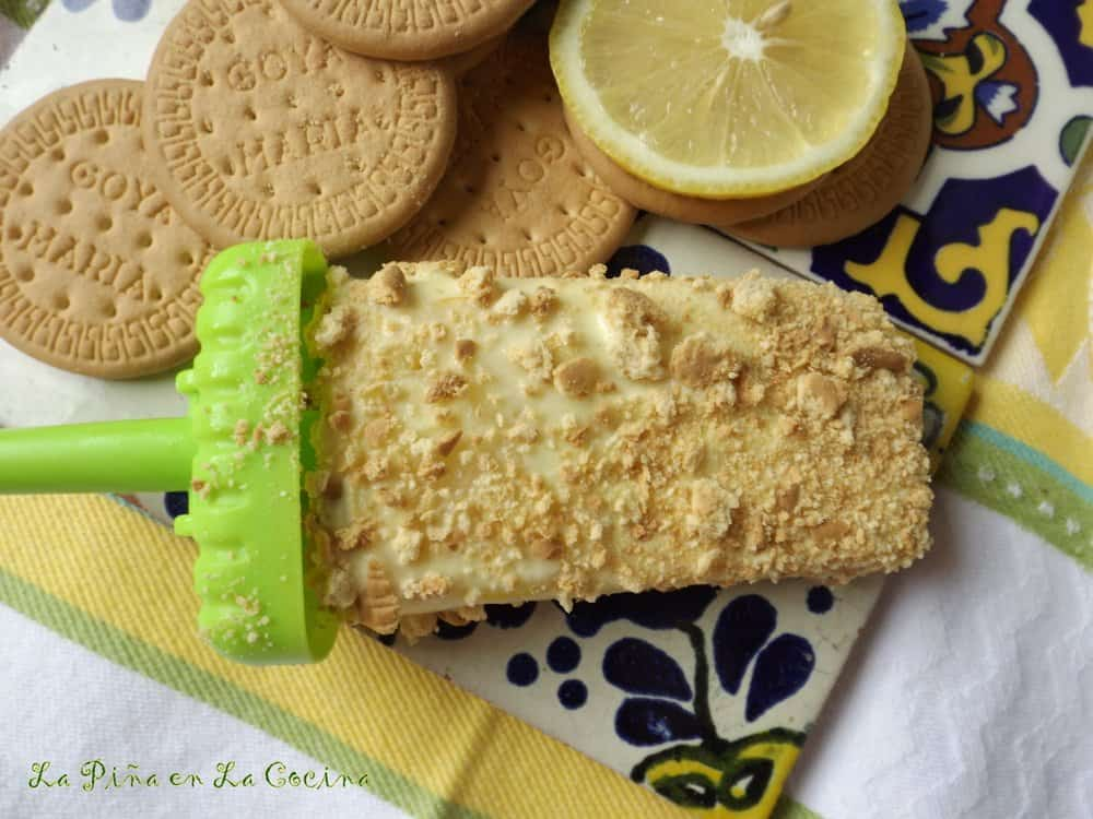 Pay de Limon Paletas-Lemon Pie Popsicles on tiles with Maria Cookies and lemon slice