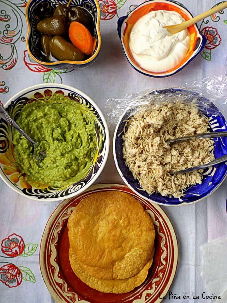 Chicken tostadas ingredients in separate bowls