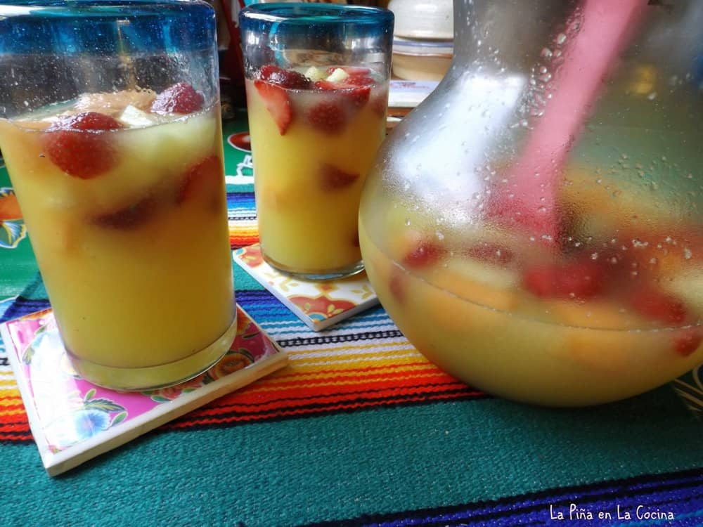 Pineapple Agua Fresca Chilled In Glasses with Pitcher On side