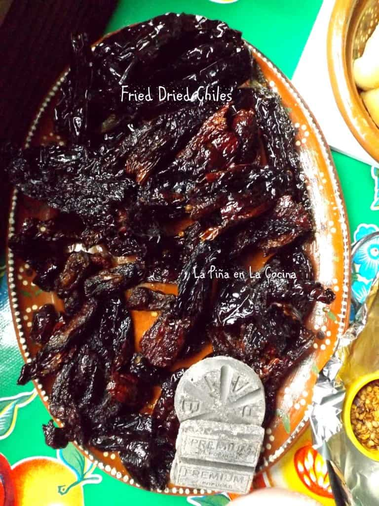Fried chiles on a platter with Mexican chocolate