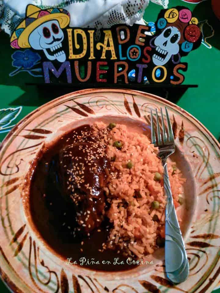 Chicken mole with rice. Fork o plate. Dia de los muertos display