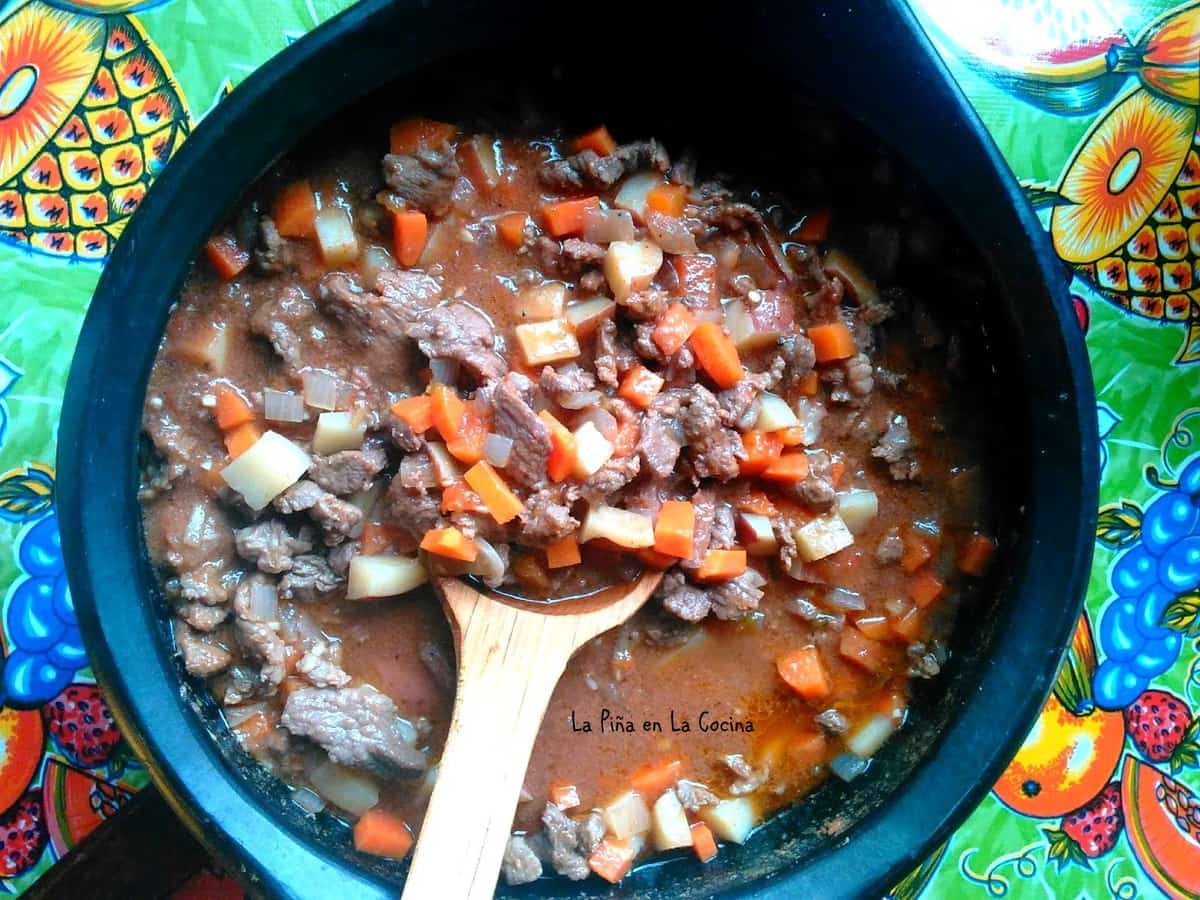 Carne Picada in pot top view with wooden spoon