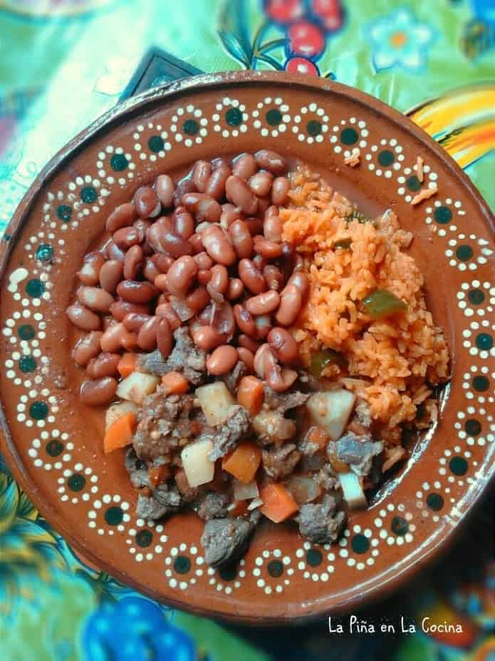 Carne Picada Con Verduras plated with rice and beans top view