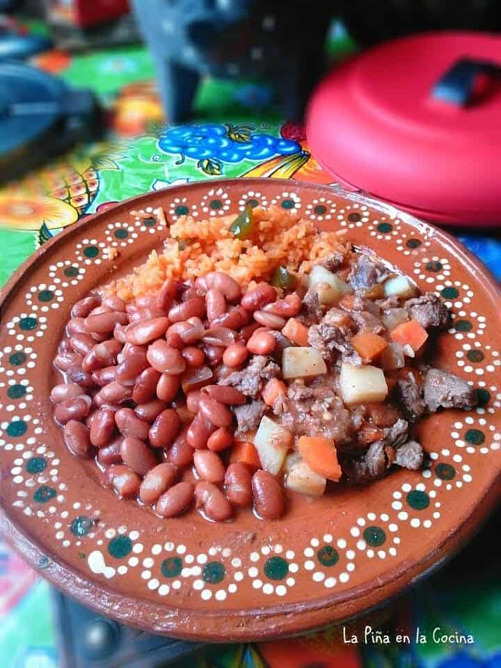 Carne Picada plated with rice and beans