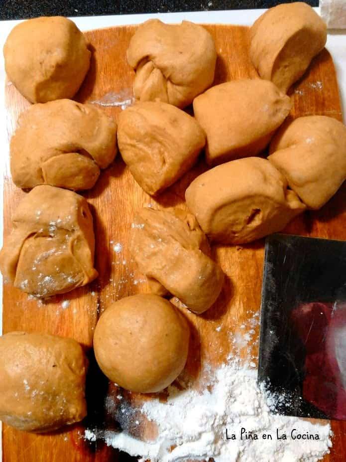Cutting dough to shape conchas