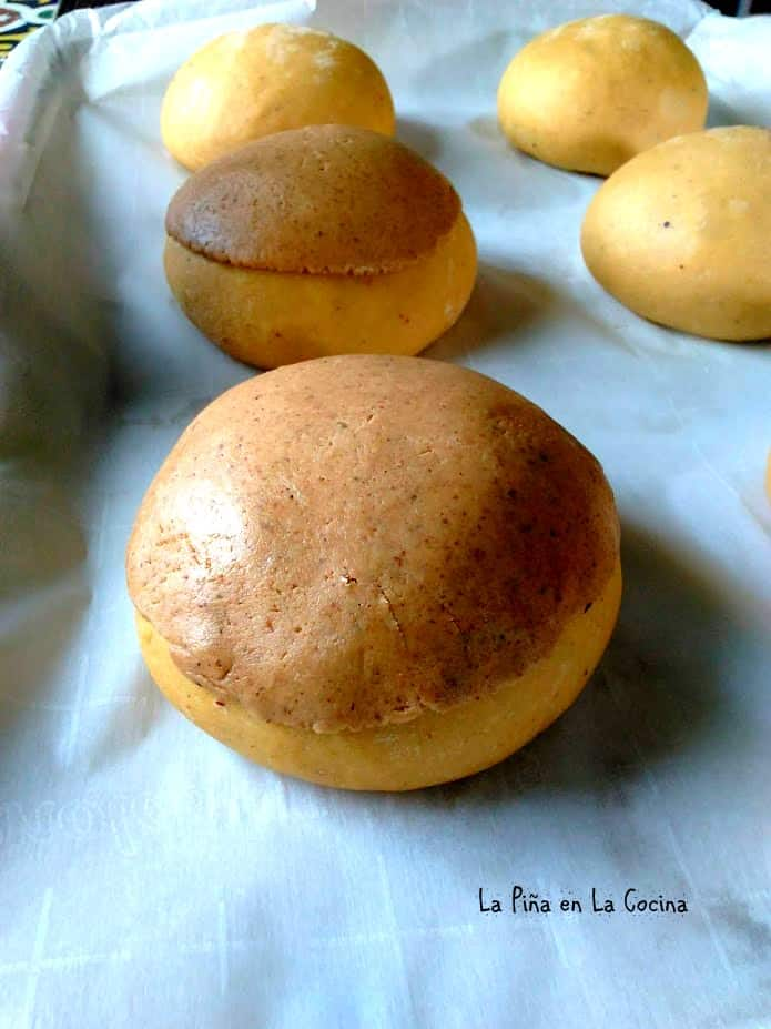 Flattened sugar topping on unbaked conchas